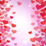 Valentines Day background with scattered blurred tender hearts Royalty Free Stock Images