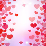 Valentines Day background with scattered blurred tender hearts Royalty Free Stock Image