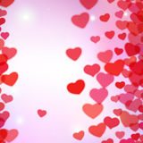 Valentines Day background with scattered blurred tender hearts Stock Image