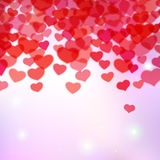 Valentines Day background with scattered blurred tender hearts Royalty Free Stock Photo