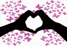 Valentines day background, silhouette of two hands making a heart shape together on a white background with butterfly`s royalty free stock photography