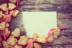 Valentines day background with small cookies Stock Images