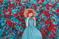 Valentines Day background. Spring rose flower garden. Fabulous lady with red lips in dress. Gardening on farm. Awesome flower wall. Redhead lady on fabulous royalty free stock image