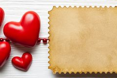 Valentine`s Day background template - red hearts and paper sheet stock photo