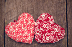 Valentines day background with two handmade toy hearts on wooden Royalty Free Stock Images