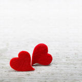 Valentines day background. With two hearts on wooden background Stock Photos