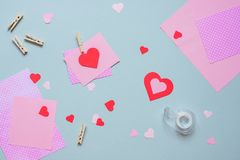 Valentines day background. Valentine card with heart and craft paper on the blue background stock image