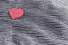 Valentines day background, valentine heart on contrasting black and white silk fabric royalty free stock photography