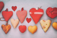 Valentines day background. Various of wooden and fabric hearts Royalty Free Stock Images