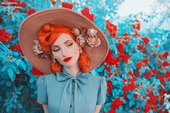 Valentines Day background. Vintage girl with red lips in awesome mint dress. Summer flowers aroma. Woman portrait. Awesome redhead. Model on background of roses stock photography