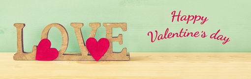 Valentines day background. Word LOVE from wooden letters Stock Photos
