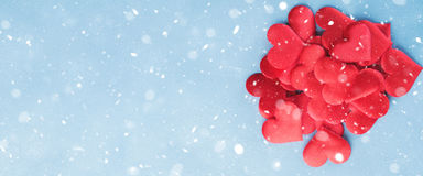 Valentines day banner background with red hearts. Snow Stock Photo