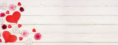 Free Valentines Day Banner With Corner Border Of Hearts, Flowers And Decor Against A White Wood Background With Copy Space Royalty Free Stock Image - 168666416