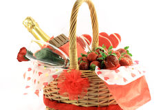 Valentines Day Basket 1. Chocolate, Strawberries, Champagne, Rose and Lollipops in decorated basket typical attributes for Valentines Day. Front view Stock Images