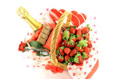 Valentines Day Basket 2. Chocolate, Strawberries, Champagne, Rose and Lollipops in decorated basket typical attributes for Valentines Day. Top view Royalty Free Stock Photo