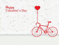 Valentines day with bicycle and ballon heart shaped on bricks wa Stock Photo