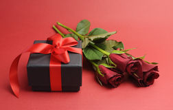 Valentines Day black box with red ribbon gift and red rose Stock Image