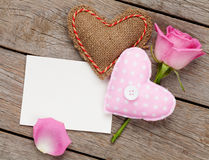 Valentines day blank greeting card or photo frame with handmaded. Toy hearts and pink rose over wooden table. Top view Stock Photos
