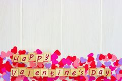 Valentines Day blocks with heart bottom border against white wood Stock Image