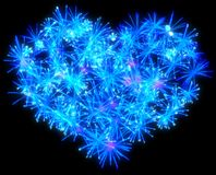 Valentines Day blue Fireworks heart shape. Over black Stock Images