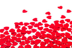 Valentines day border of red hearts confetti with copy space on white background. Festive Valentine Stock Images