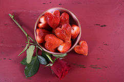 Valentines Day bowl of luscious heart shape red strawberries Royalty Free Stock Photo