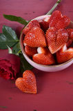Valentines Day bowl of luscious heart shape red strawberries Stock Photography