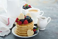 Valentines day breakfast, pancakes with hearts topping royalty free stock photos