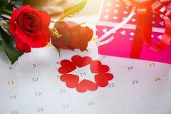 Valentines day calendar love time concept / Calendar page with red heart on February 14 of Saint Valentine`s day stock photos
