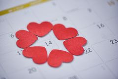Valentines day calendar love time concept Calendar page with red heart on February 14 of Saint Valentine`s day stock image