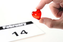 Valentines Day calendar page with man holding little red heart Royalty Free Stock Image