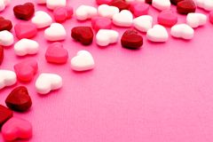 Valentines Day candy background. Valentines Day candy forming a border on a pink textured background Stock Images