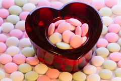 Valentines Day candy. Heart-shaped glass bowl filled with candy for Valentines Day stock photography