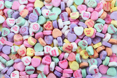 Valentines day candy hearts. Valentines day background featuring multi-colored hard sweetheart candy with love messages Stock Images