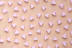 Valentines Day candy hearts marshmallows over green background Stock Photo