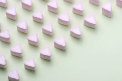 Valentines Day candy hearts marshmallows over green background.  royalty free stock photo