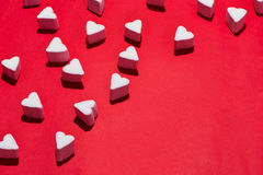 Valentines Day candy hearts marshmallows over red background Stock Image