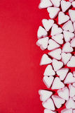 Valentines Day candy hearts marshmallows over red background Stock Photo