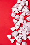 Valentines Day candy hearts marshmallows over red background Royalty Free Stock Photo