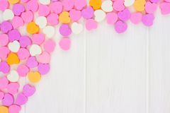 Valentines Day candy hearts top corner border over white wood Royalty Free Stock Photos