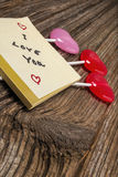 Valentines day candy,sticky-note pad on barnwood stock images