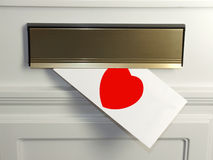 Valentines day card. A Valentines day card hangs out of a letter box Stock Images