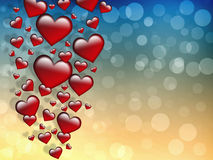 Valentines Day Card. Valentin`s Day Card with red Hearts on a gradient blue gold background with bokeh Stock Photos