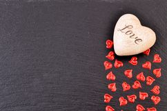 Valentines day card. Background whith heart, on black stone Royalty Free Stock Photos