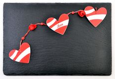 Valentines day card. Background whith heart, on black stone Royalty Free Stock Image