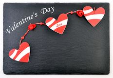 Valentines day card. Background whith heart, on black stone Stock Image