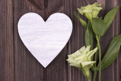 Valentines day card concept. With white wooden heart and natural white flowers. Love. Wedding Royalty Free Stock Image