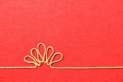 Valentines day card - flower made from wire on red background Stock Photos