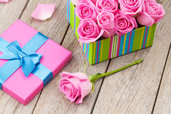 Valentines day card with gift box full of pink roses Stock Photography