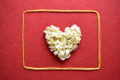 Valentines day card - heart made of ribbon on red background Stock Photo